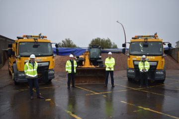 Councillor Swinburn and ENGIE officers stand with some of the gritters gearing up for the winter.