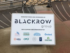 A sign showing the logos of the main sponsors
