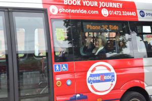 Phone n ride passenger waving