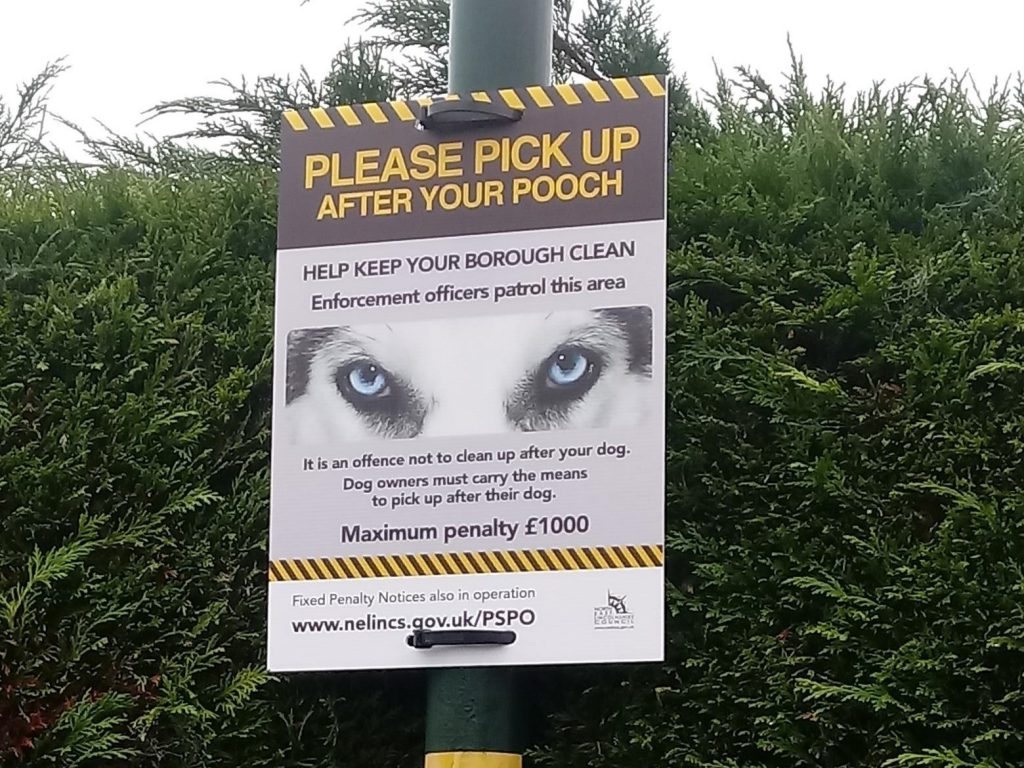 New dog fouling warning sign attached to a lamp post in Scartho, Grimsby