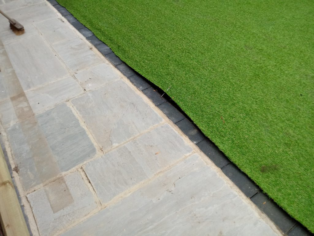 Some of the shoddy fitting of the artificial grass