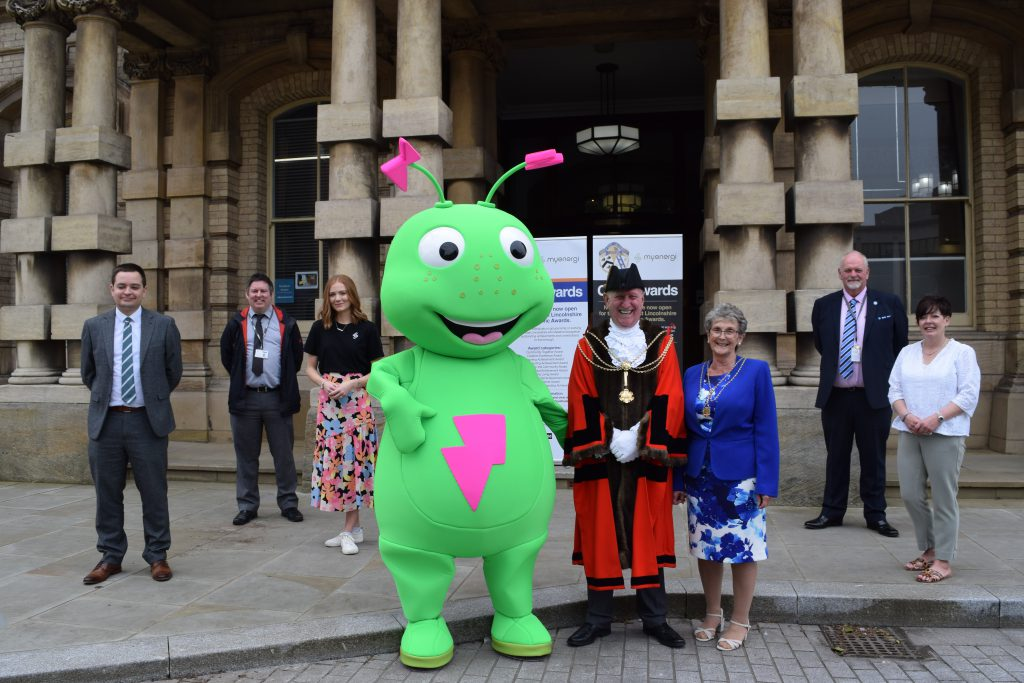 Mayor of North East Lincolnshire poses for a photo with sponsors of the new Civic Awards