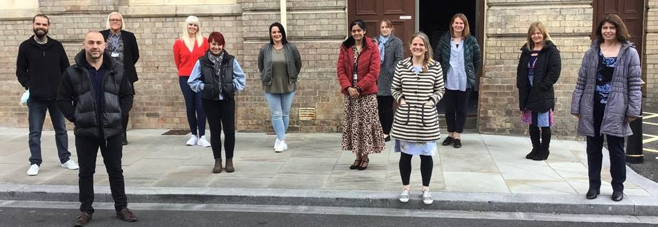 Trainee Emotional Literacy Support Assistants pose for a photo outside Grimsby Town Hall