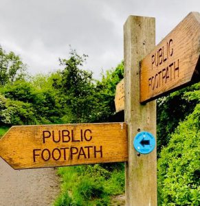 A sign leading the way to a FitRoutes trail