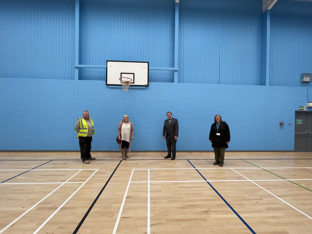 Members of the project group post for a photo in the newly refurbished sports hall