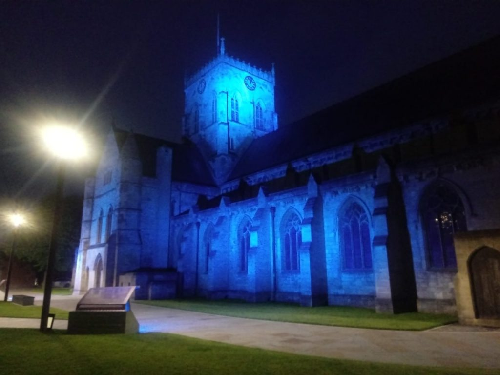 A photo of Grimsby Minster lit up blue