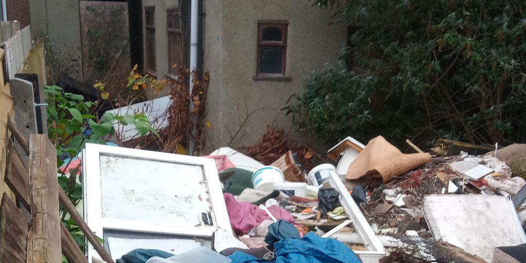 Heaps of waste in a Grimsby garden.